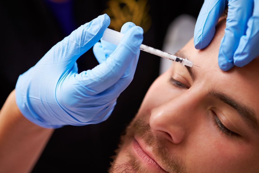Botox injection on the brow of a male patient