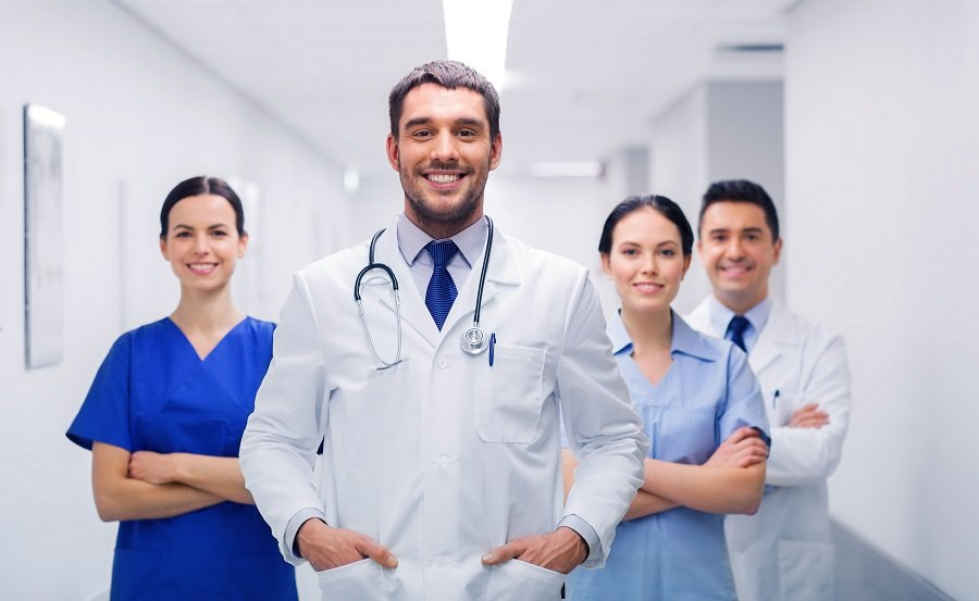 Male doctor and staff